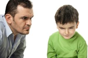 Dad disciplining son